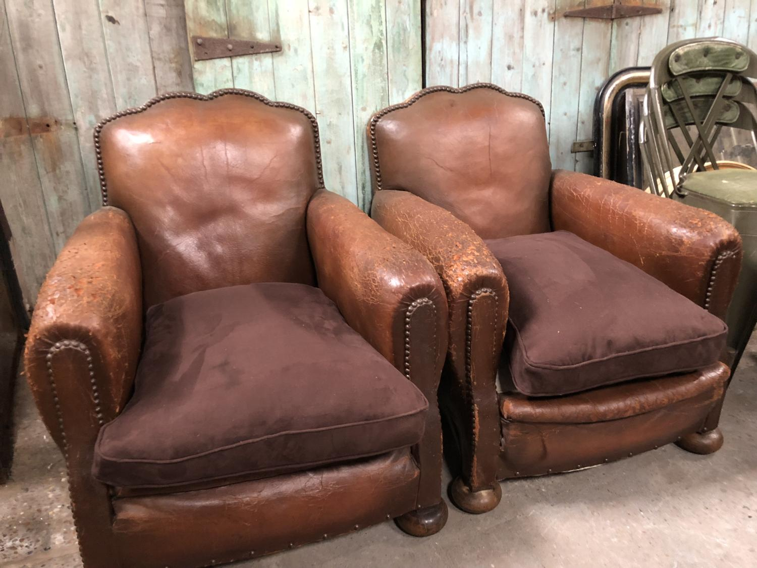 A pair of early 20th Century French Club Chairs with Balled Feet