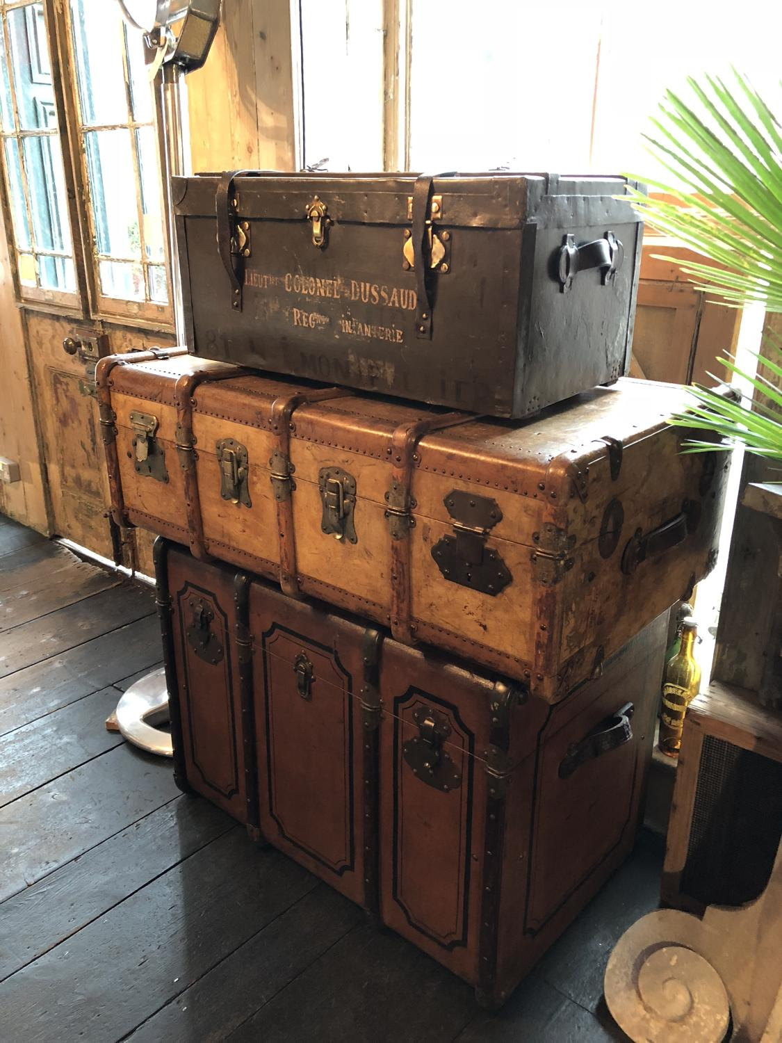 A selection of early 20th Century military & domestic trunks