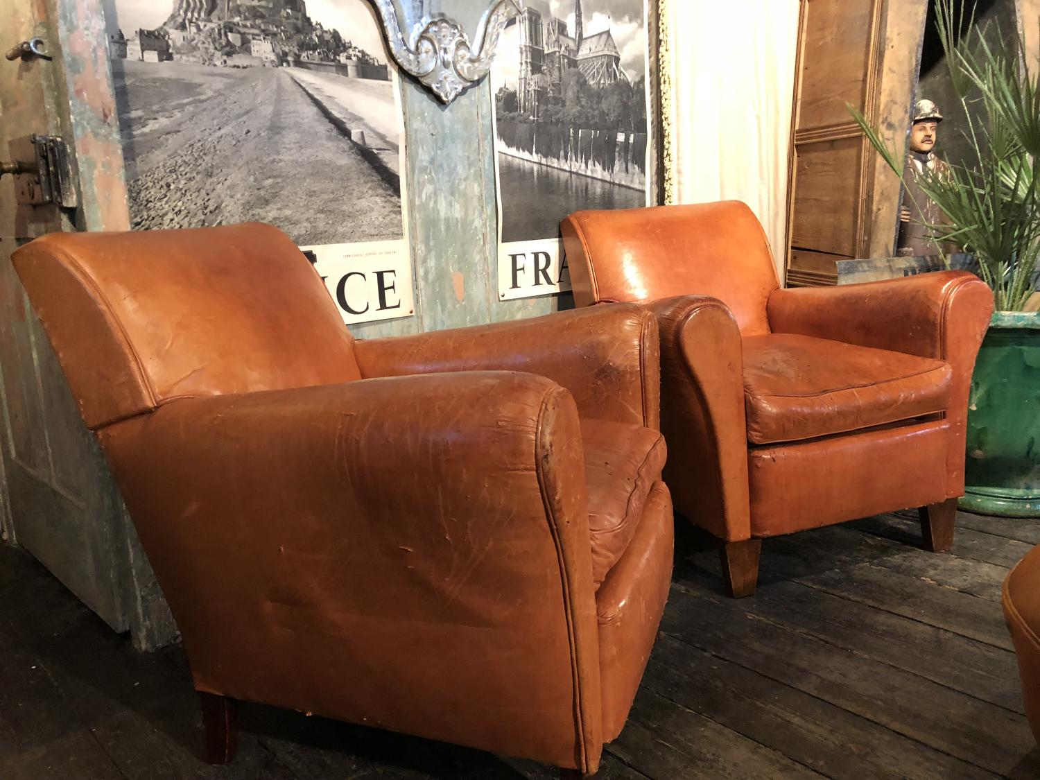 A pair of mid 19th Century leather honey coloured club chairs
