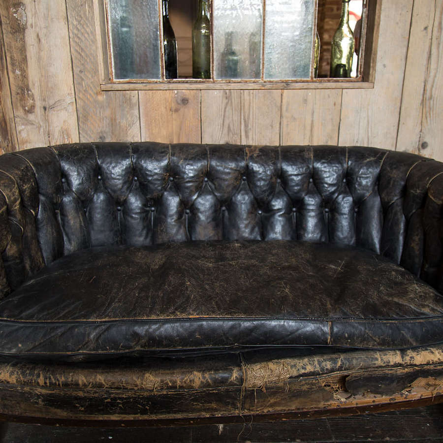 A wonderful 140cm wide Salon Leather Sofa with Original Cushion