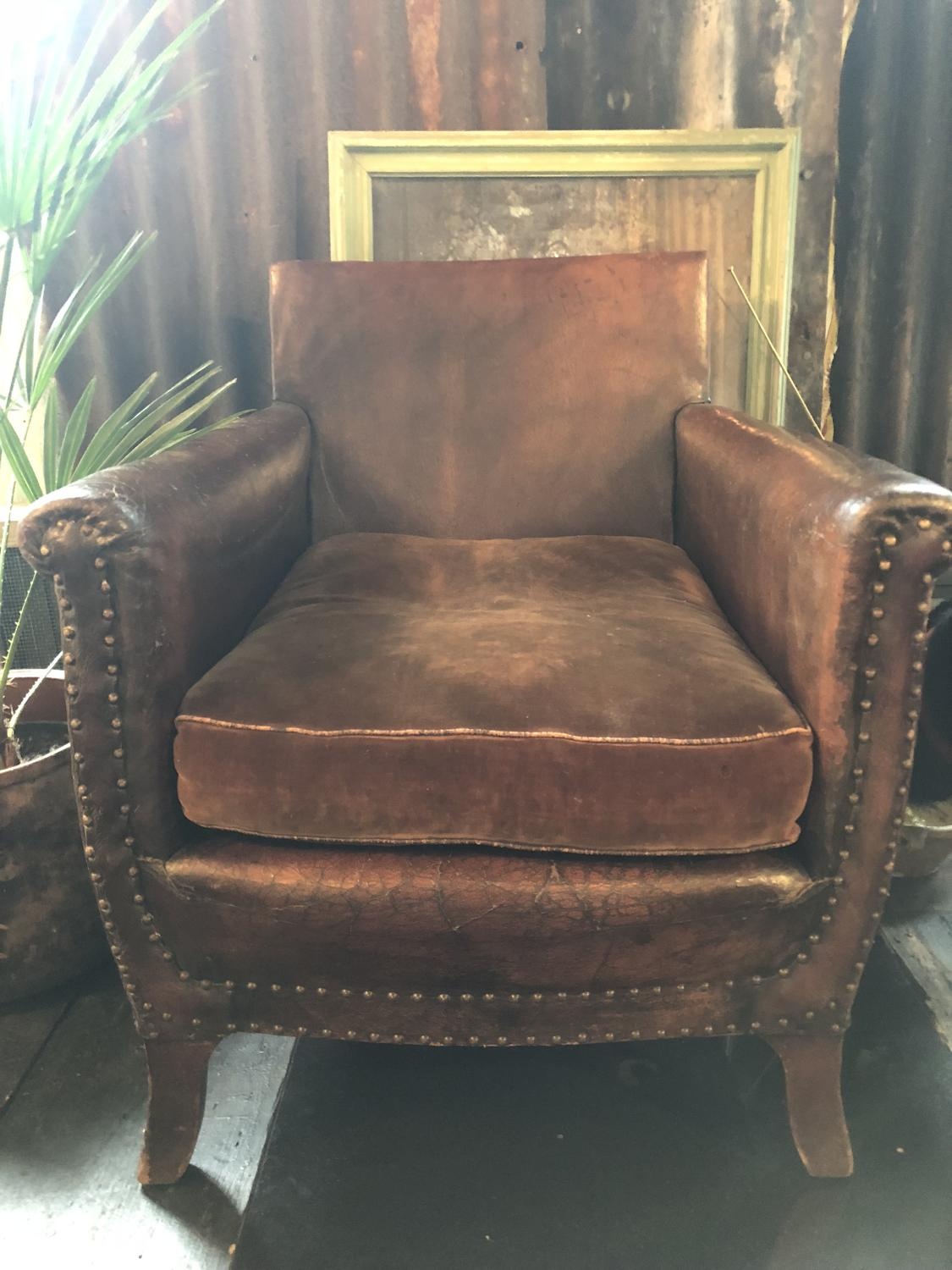 Early 20th Century Leather Armchair with original cushion